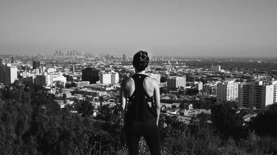 A woman observing the view from Runyon Canyon