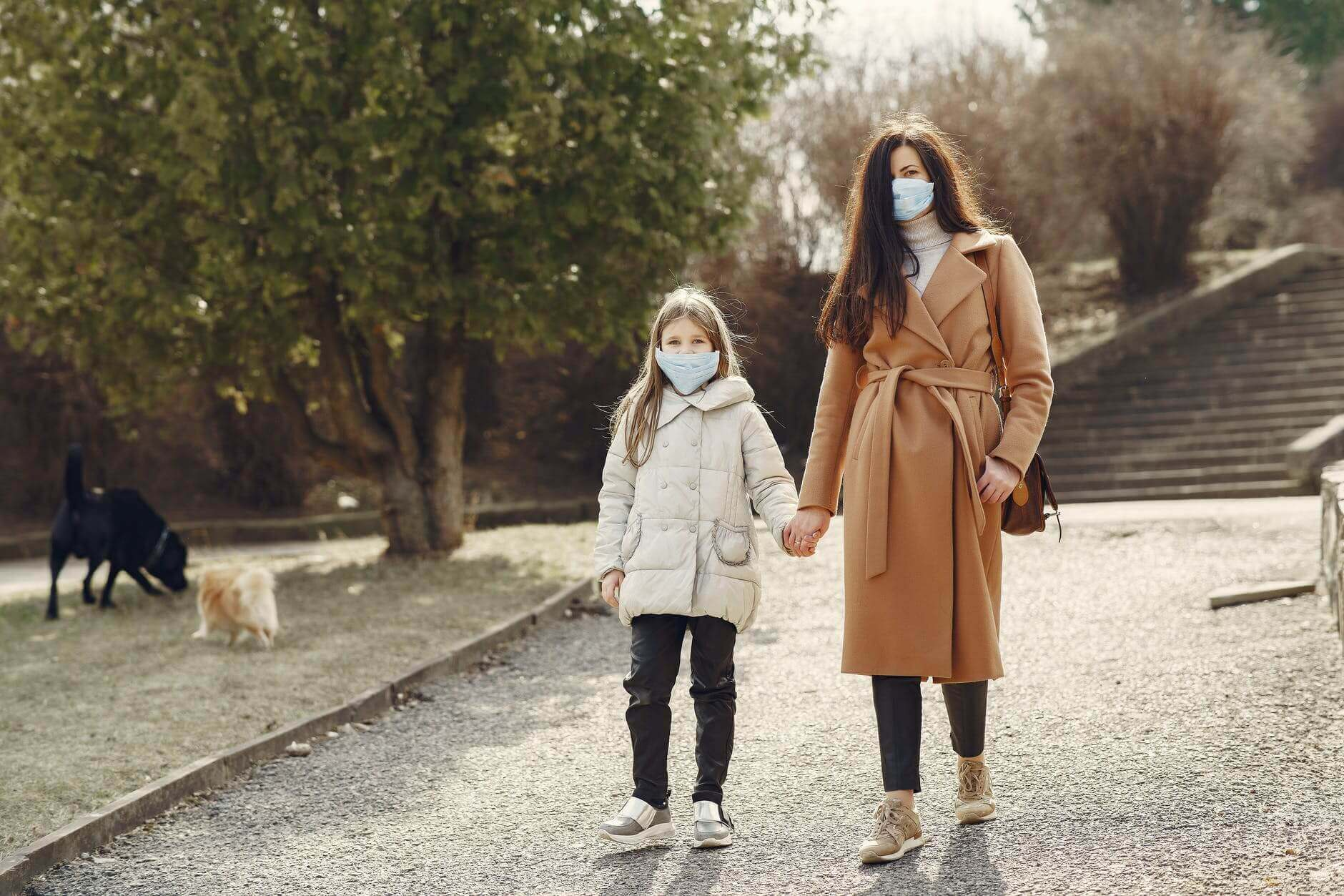 An image of a woman and her daughter walking.