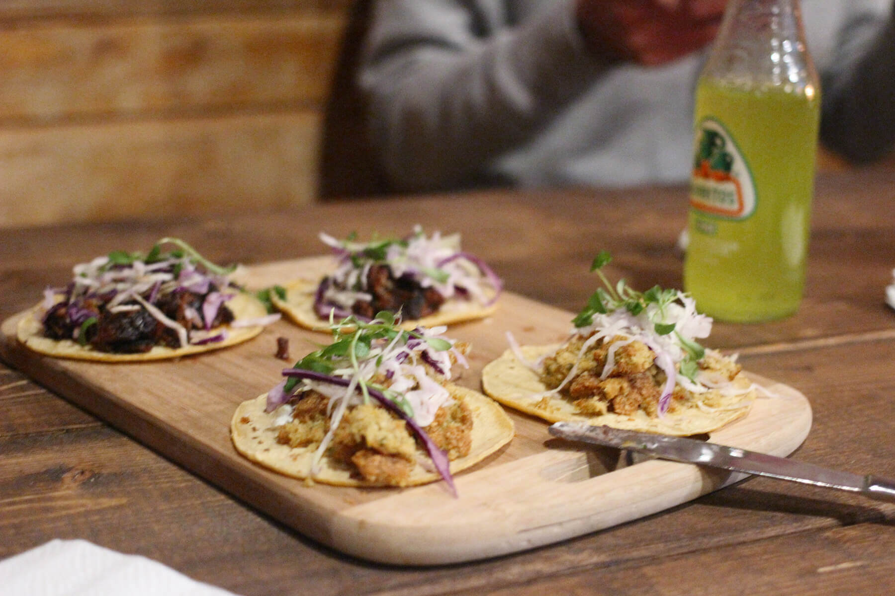 A dining table with tacos