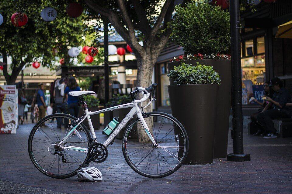 A bike and a helmet on the street