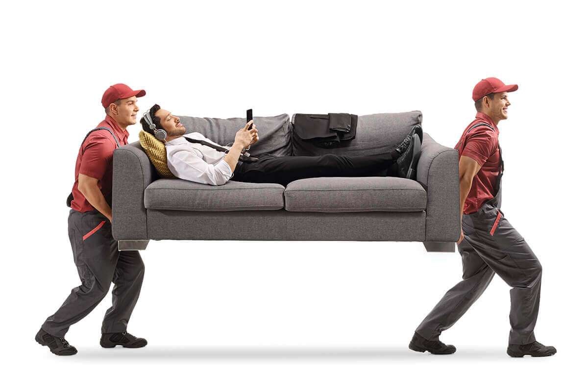 Movers carrying a person on a couch.