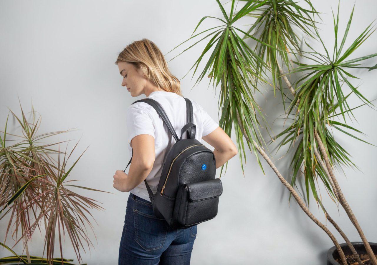 Woman wearing a black backpack